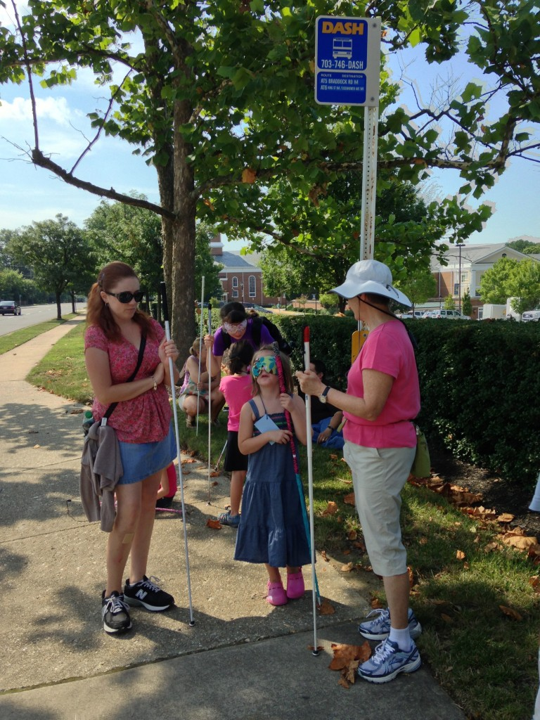 A group of blind students, teachers, and mentors walking in Alexandria, Virginia as part of the NFB-BELL Program (July 2013)