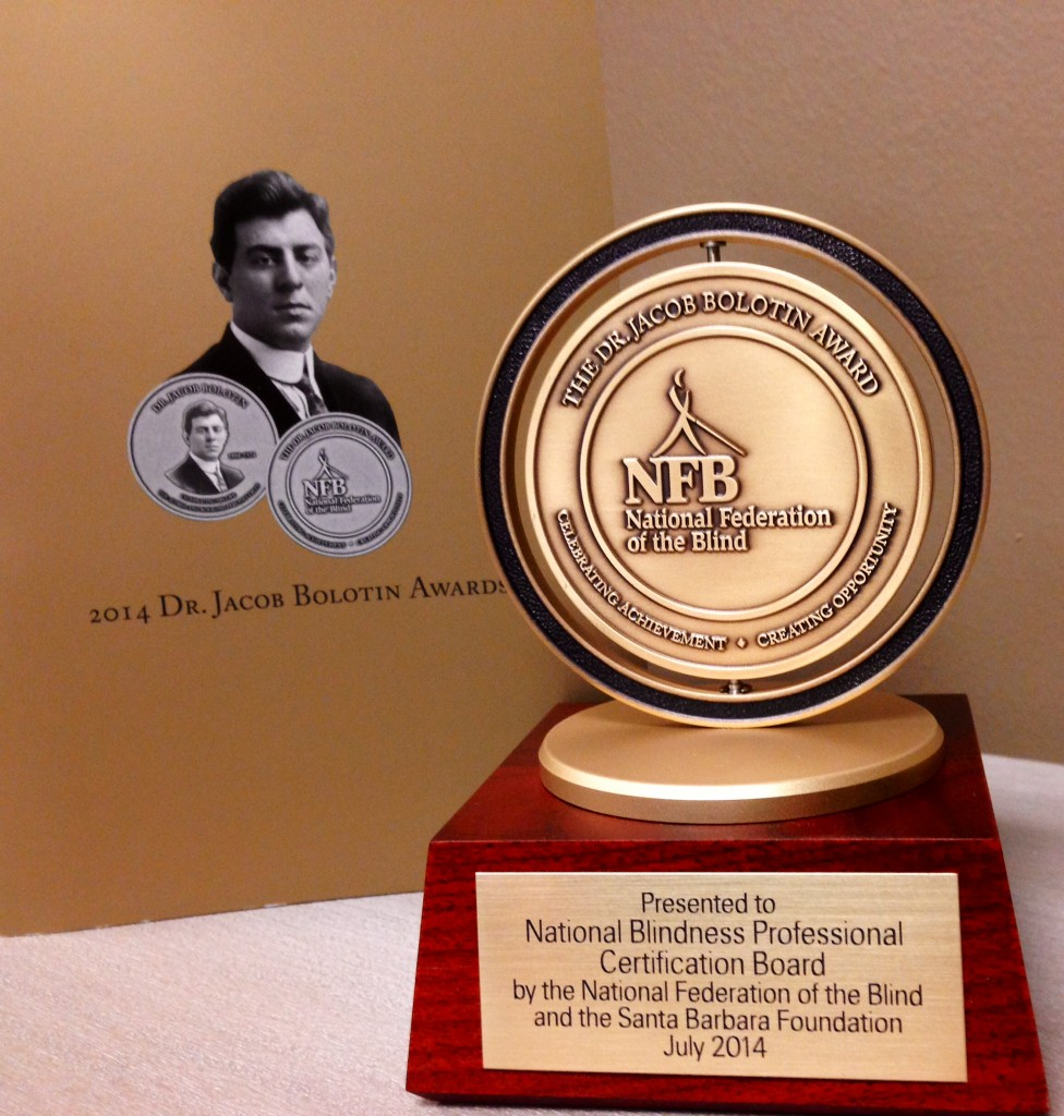 2014 Jacob Bolotin Award pictured with the booklet announcing the winners and accomplishments