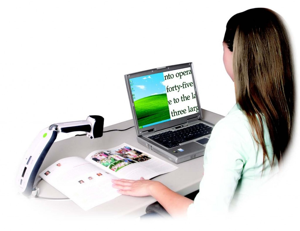 Lady sitting in front of computer with a vertical, split-screen and Transformer camera over document