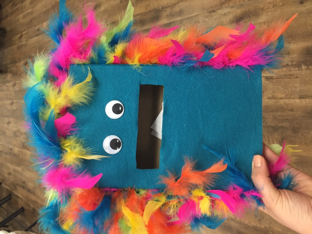 The Braille Monster, a blue cereal box with eyes and a mouth to accept index cards